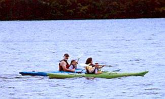 Family Campers kayaking on the lake