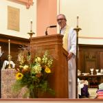 Bishop Gates giving McCreath installation sermon